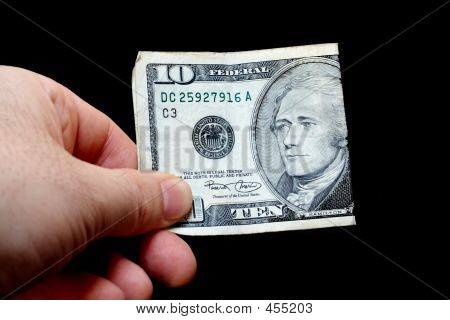 Man Holding A Ten Dollar Bill, Isolated On Black Background