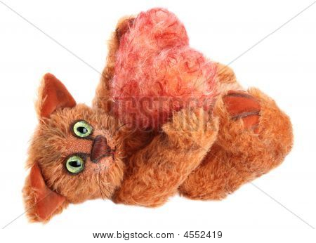 Unique Red Cat Holding Fluffy Heart In His Paws On White Background