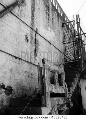 Alcatraz Prison, San Francisco, Us - June 2005: A View Of The Concrete Stairs And Chainlink Gate On
