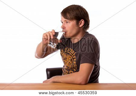 Man Drinking Water In A Glass