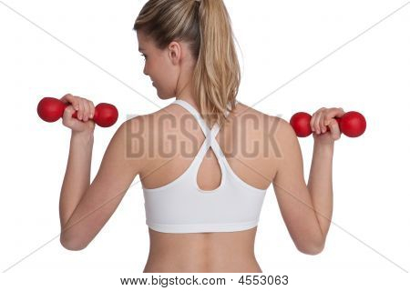 Woman Exercising With Red Weights
