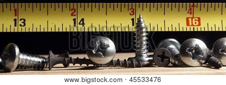 Tools Screws Wood and Tape Measure
