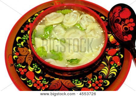 Russian Folk Dishes Called Khokhloma And Traditional Siberian Dumplings.