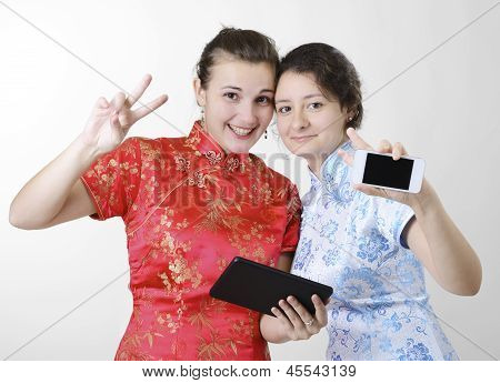 Happy Women With Mobile Devices