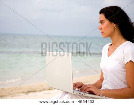 Beach Woman On A Laptop