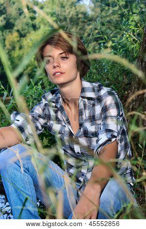 Young Beautiful Woman Near River