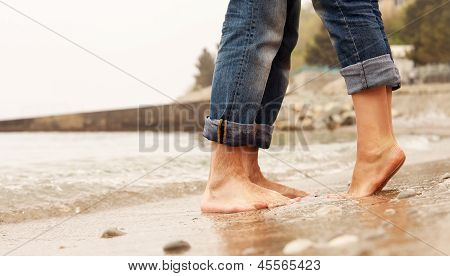 Closeup Image Couple Legs At The Beach