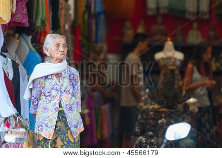 Old Balinese Woman Near Souvenir Shop In Ubud