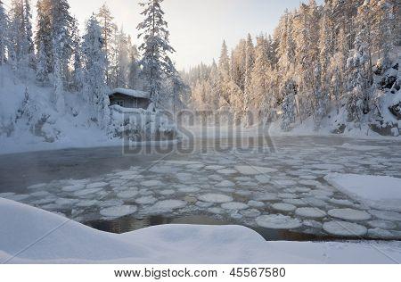 Hut Near Pond In Winter Forest