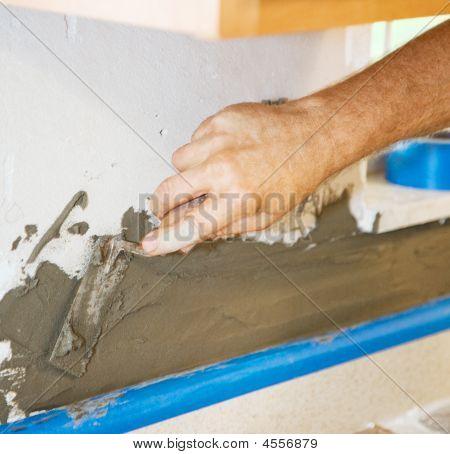 Applying Morter To Wall