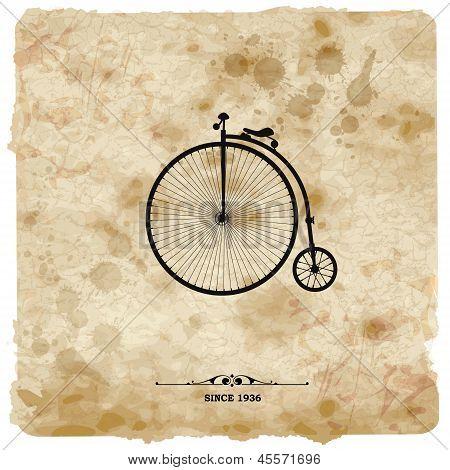 Postal Vintage. Bicicleta retro sobre fondo Grunge