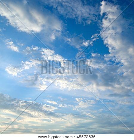 The White Cumulus Clouds Against The Blue Sky
