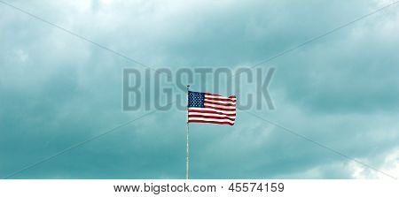 american flag wavering in the wind
