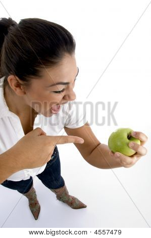 Young Model Indicating The Apple