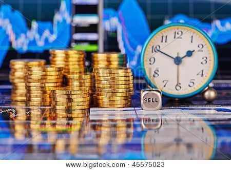 Stacks Of Golden Coins, Clock, Dices Cube With The Words Sell. The Financial Chart As Background. Se