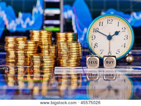 Stacks Of Golden Coins, Clock, Dices Cubes With The Words Sell Buy. The Financial Chart As Backgroun