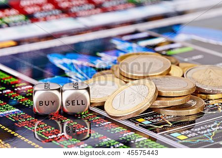 Dices Cubes With The Words Sell Buy, One-euro Coins And A Financial Chart As The Background. Selecti
