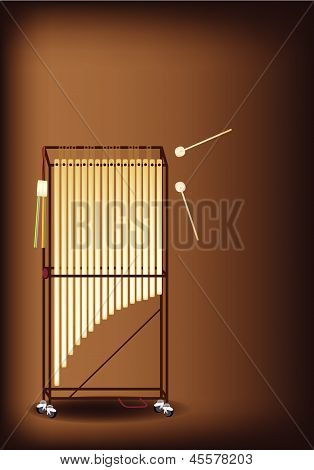 A Musical Tubular Bells On Dark Brown Background