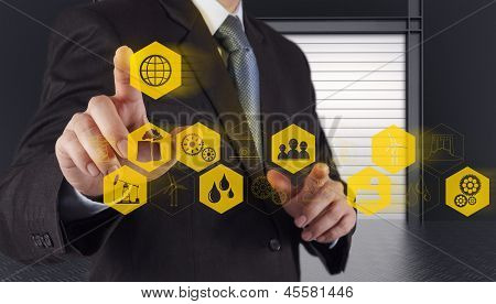Business Engineer Hand Works Industry Diagram On Virtual Computer