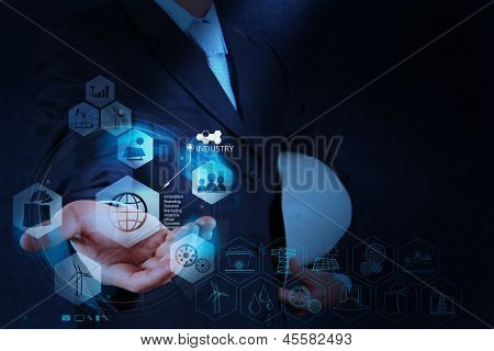 Engineer's Hand Showing World Of Industry As Concept