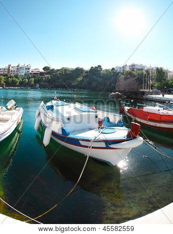 Boats At Voulismeni Lake In Agios Nikolaos. Crete
