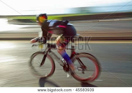 Athlet Riding Bicycle