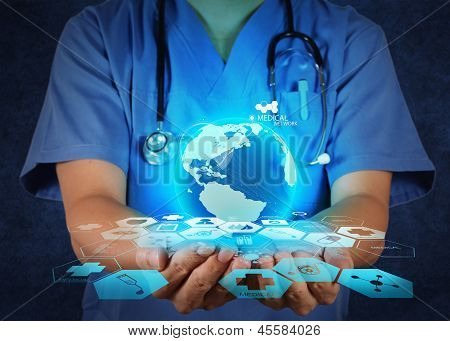 Medical Doctor Holding A World Globe In Her Hands As Medical Network
