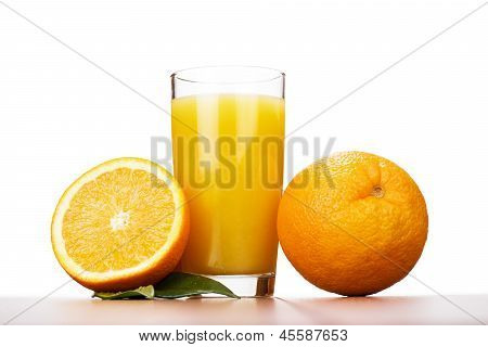 fresh orange and glass with juice over white