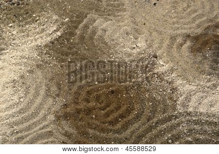 Circles On Multitoned Brown Sand Surface
