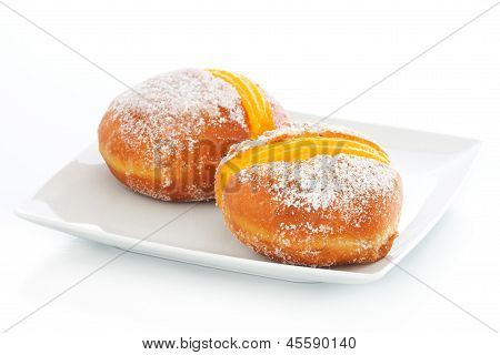 Two Berliner With Egg Creme On A Plate