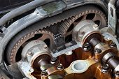 stock photo of pulley  - Car engine head two camshaft system pulley and belt - JPG