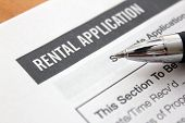 image of rental agreement  - close up of rental application with pen - JPG