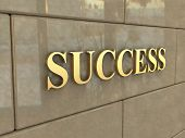 stock photo of chisel  - The word Success is chiseled by gold letters on a stone wall - JPG