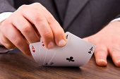 stock photo of cheater  - Image of Business man showing playing cards - JPG