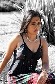 foto of filipina  - Beautiful Filipina modelling outdoors in red and black dress - JPG