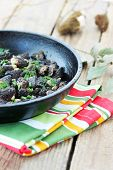 stock photo of morel mushroom  - Morels mushrooms fried in a pan with onions - JPG