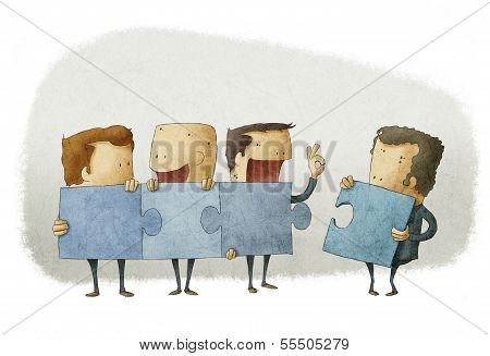 people holding pieces of a jigsaw
