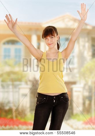 Woman on the house and hands up