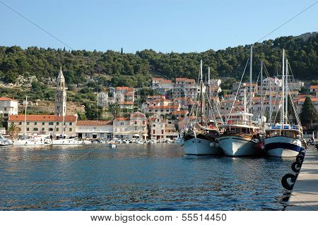 Hvar And Its Harbor With Tourist Ships