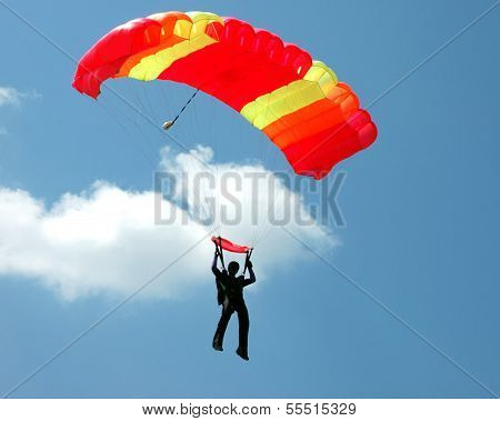 Parachuter With A Yellow-red Parachute