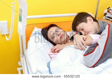 Sad Middle-aged Woman Lying In Hospital With Son