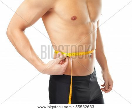 Muscular Young Man Measuring Waist