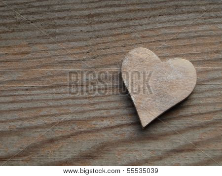 Wooden background with a heart
