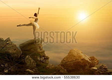 Mystic pictures ballet dancer stands on the cliff edge