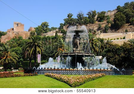 Fountain with castle to rear, Malaga.