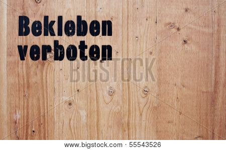 Wooden background showing the term gluing prohibited in german