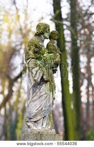 Statue In A Cemetery At Fall
