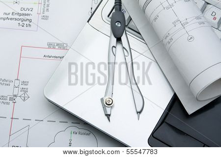 Dividers and a protractor on a draft, closeup
