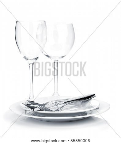 Silverware or flatware on plates and wine glasses. Isolated on white background
