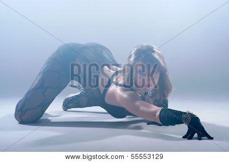 Sexy Woman Dancing. Photo In A Studio